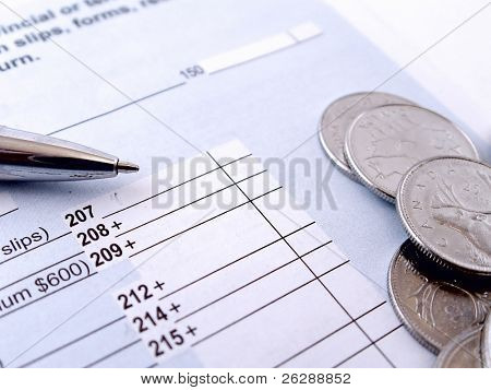 Income Tax Form with pen and money