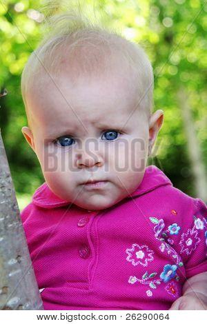 Little Baby Girl posing in trees