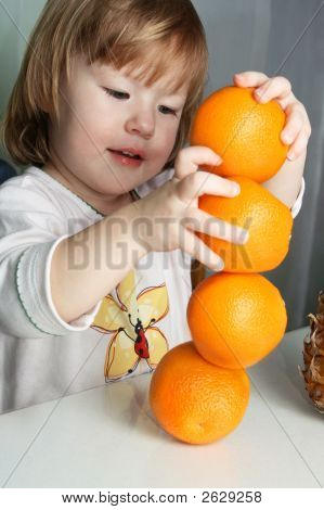 Girl And 4 Oranges