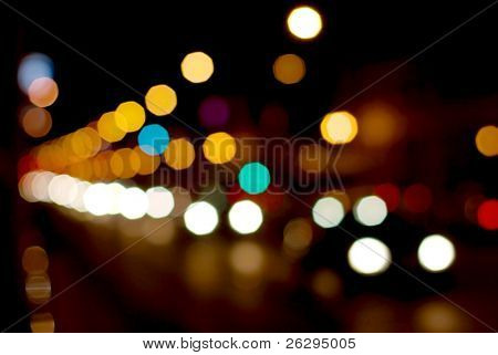 Out of focus light of traffic on a street at night