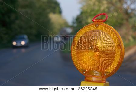 Yellow warning light at a road construction