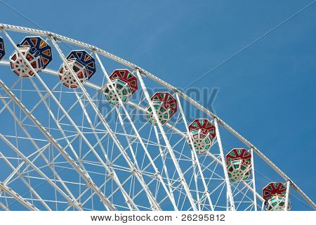 Tall observation wheel in an amusement park