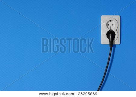 Electric outlets on a blue wall