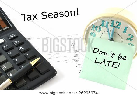 Concept Image With Calculator And Clock. Tax Season! Don`t Be Late!
