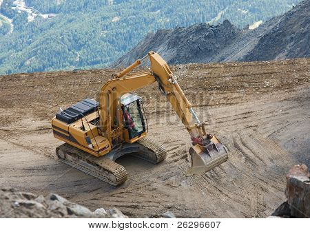 Construction machinery in a mountain landscape