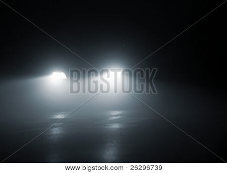 headlights of a car approaching in the dark