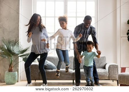 Happy Black African Family Dancing