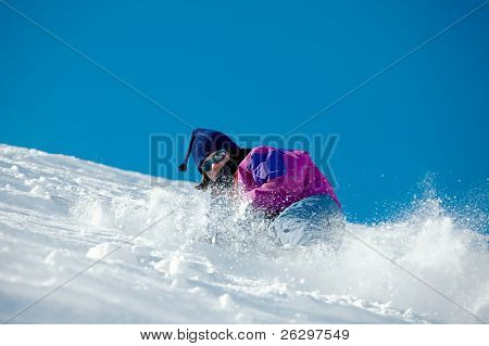 Skier coming down a steep slope