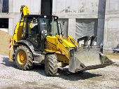Backhoe loader at construction site