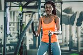 Low-angle view of a strong and beautiful African American woman, exercising alternative waves with b poster