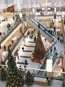 Multilevel shopping mall interior decorated with christmas trees - aerial view