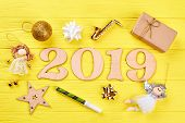 Wooden Number 2019 And Christmas Ornaments. Wooden Numbers Forming The Number 2019 For The New Year  poster