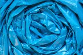 Blue Garbage Bag Texture. Cellophane Twisted Crumpled Plastic Background poster