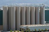 stock photo of boxcar  - The modern silos of a manufacturing plant and the train - JPG
