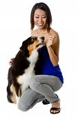 pic of asian woman  - A young Asian woman with her dog on white background - JPG