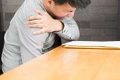 Businessman Suffering From Pain In Shoulder, Office Syndrome Concept poster