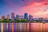 Little Rock, Arkansas, USA skyline on the Arkansas River at dusk.  poster