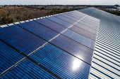 Sun Reflects Off Panels On Rooftop Installation , Solar Panels On Rooftop , Bright Blue Colorful Tec poster