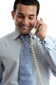 Businessman Communicating By Telephone