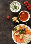 Seafood Mix on White Plate, Cold Okroshka and Hot Meat Soups, Croutons, Vegetables, Herbs Top View.  poster