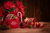 Christmas decoration with Red Poinsettia flowers (Euphorbia Pulcherrima), fir cones and branch, red  poster