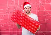 Santa Bring Gift For You. Man Attractive Santa Claus Carry Big Box. You Deserve Good Gift. Christmas poster