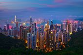Famous view of Hong Kong - Hong Kong skyscrapers skyline cityscape view from Victoria Peak illuminat poster