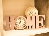 Home Decoration Of Letters Home, Clock And A Bowl Of Wicker From A Vine. Beautiful Writing Home With poster