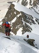 group of climbers at the Tepliy Ugol Bezenghi Ural at Caucasus mountains near Elbrus