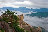 pic of seoraksan  - Hanging stone at the Ulsanbawi Rock against the fog seorak mountains at the Seoraksan National Park - JPG