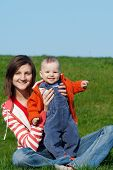 image of mother baby nature  - Happy mother with son sitting on green grass - JPG
