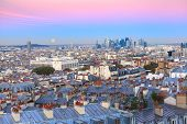 Aerial View From Montmartre Over Paris Roofs And La Defense Business District With Full Moon At Sunr poster