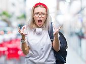 Young blonde student woman wearing glasses and backpack over isolated background crazy and mad shout poster