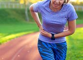 Side Stitch - Woman Runner Side Cramps After Running. Jogging Woman With Stomach Side Pain After Jog poster