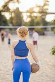 Young Beautiful Sporty Girl Outdoor In Volleyball Game. Back View. Attractive Slim Sexy Woman Standi poster