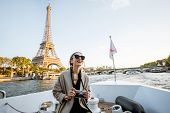 Young Woman Enjoying Beautiful Landscape View On The Riverside With Eiffel Tower From The Boat Durin poster
