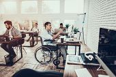 Man On Wheelchair Working On Computer In Office. Disabled Young Man. Man On Wheelchair. Recovery And poster