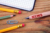 News Text On Pencil. Social Media, Propaganda And Information. Stationery On An Old Wooden Backgroun poster