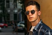 Close-up Of A Man Whish Sunglasses, Male Portrait. Close Up Shot Of Young Man On Country.caucasian M poster