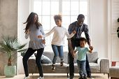 Happy Black African Family Dancing At Home poster