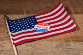 I Voted Today Sticker  For Voters In The Us Elections With Usa Flag On Rustic Wooden Table poster