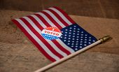 Narrow Focus On I Voted Today Sticker  For Voters In The Us Elections With Usa Flag On Rustic Wooden poster