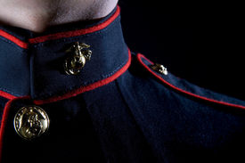 image of united states marine corps  - A United States Marine wearing Dress Blues in a studio environment - JPG