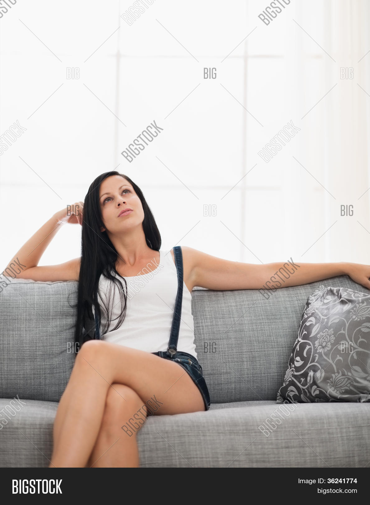 thoughtful girl sitting on couch image photo bigstock. Black Bedroom Furniture Sets. Home Design Ideas
