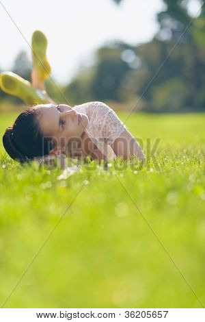 Thoughtful Girl Laying On Meadow