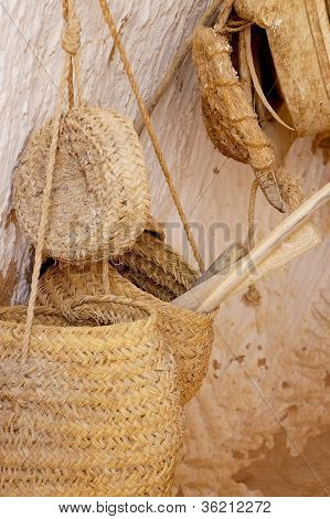 Straw baskets and wooden tools
