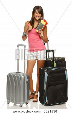 Female with suitcases holding tickets