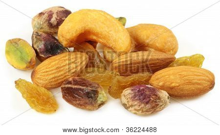 Mixed nuts with raisin over white background
