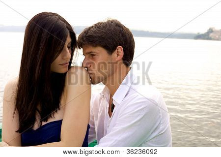 Handsome Man In Love Kissing Shoulder Of His Wife