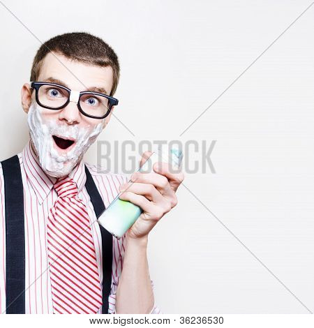 Male Nerd With Sensitive Skin Having Morning Shave